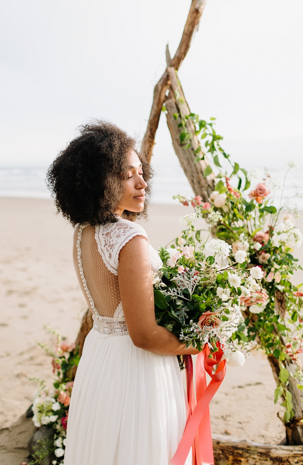 oregon beach elopement with a driftwood arbor