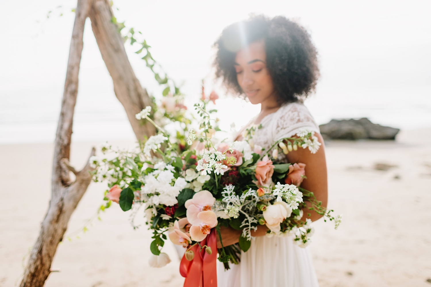 bride holding a bouquet on hug point