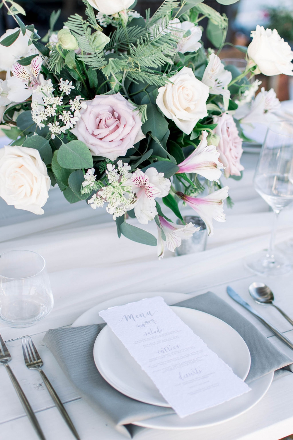 wedding table place setting with a grey napkin.