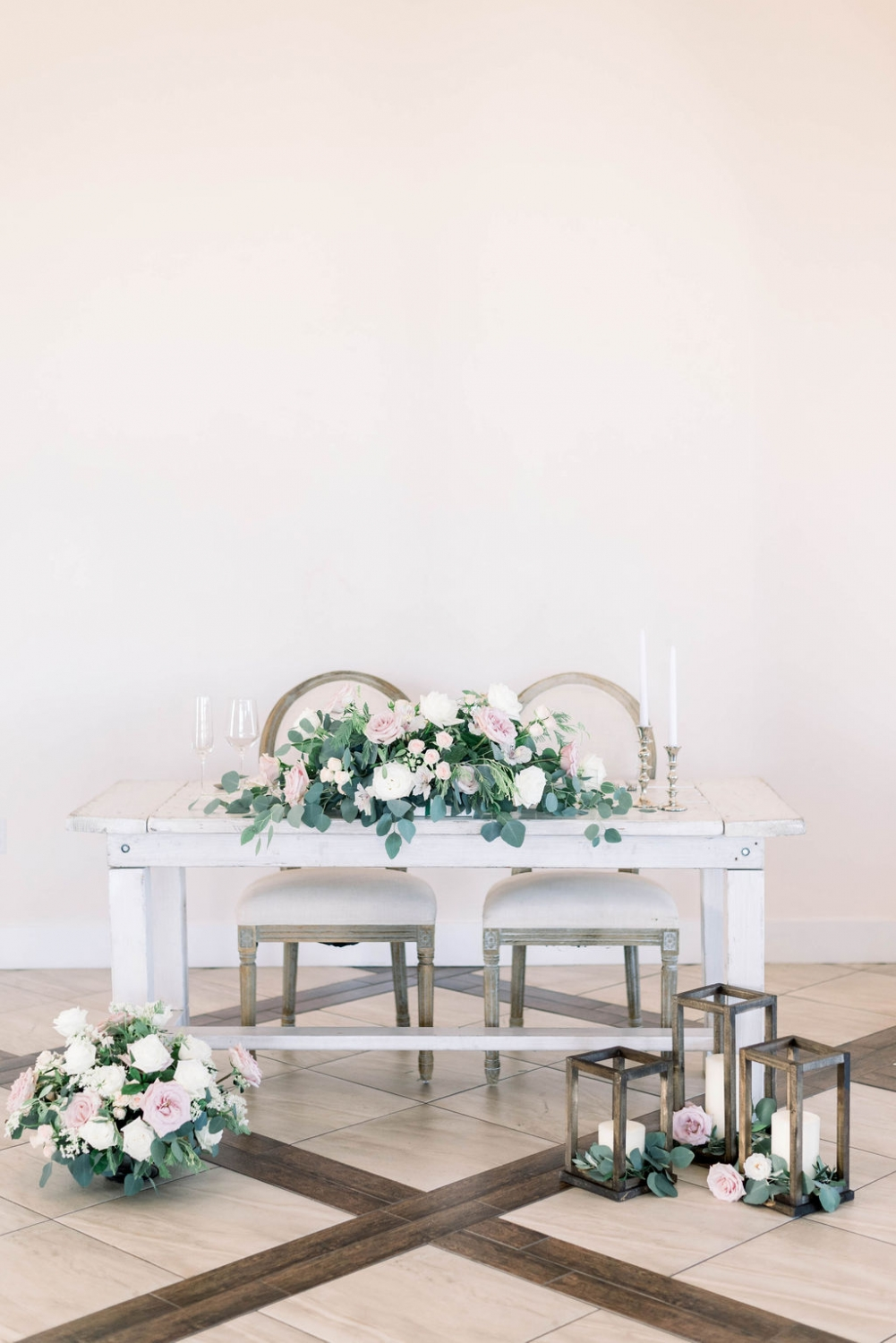 farm style bride and groom table with rustic accents