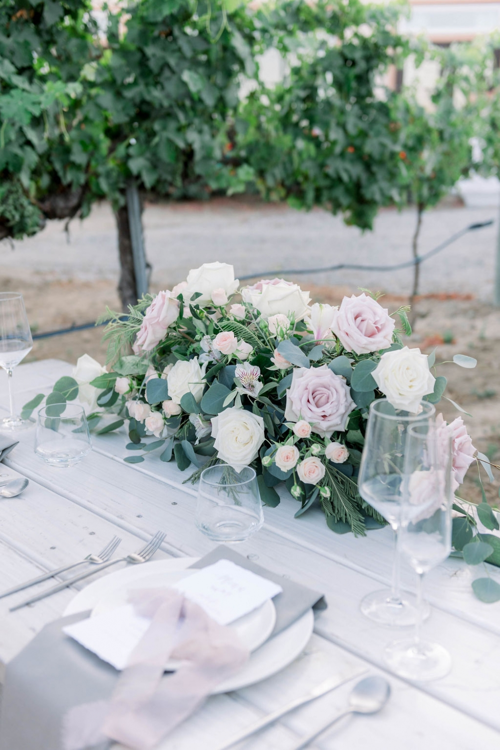 pink and blush roses arranged in a centerpiece