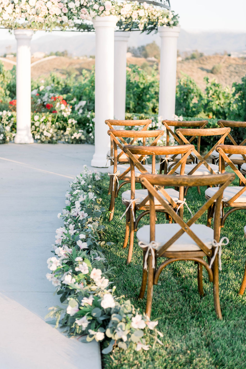wooden farmstyle chairs used in wedding ceremony
