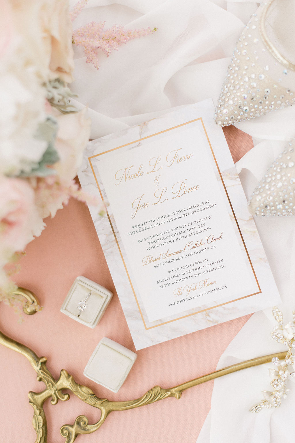 blush and floral wedding invitation with a border