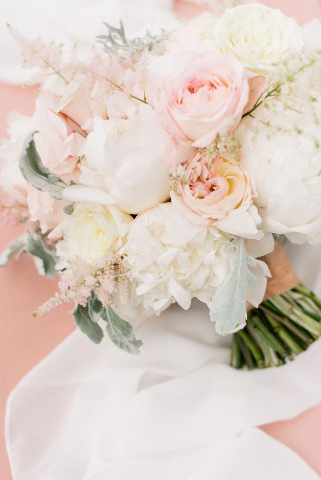 light colored rose bouquet with evenly cut stems