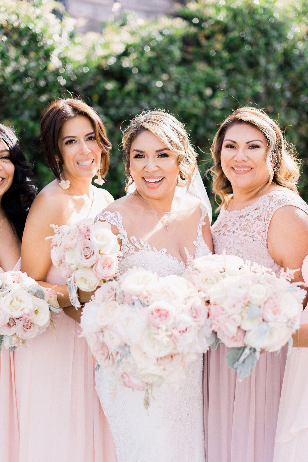 bride with her pretty pink bridesmaids