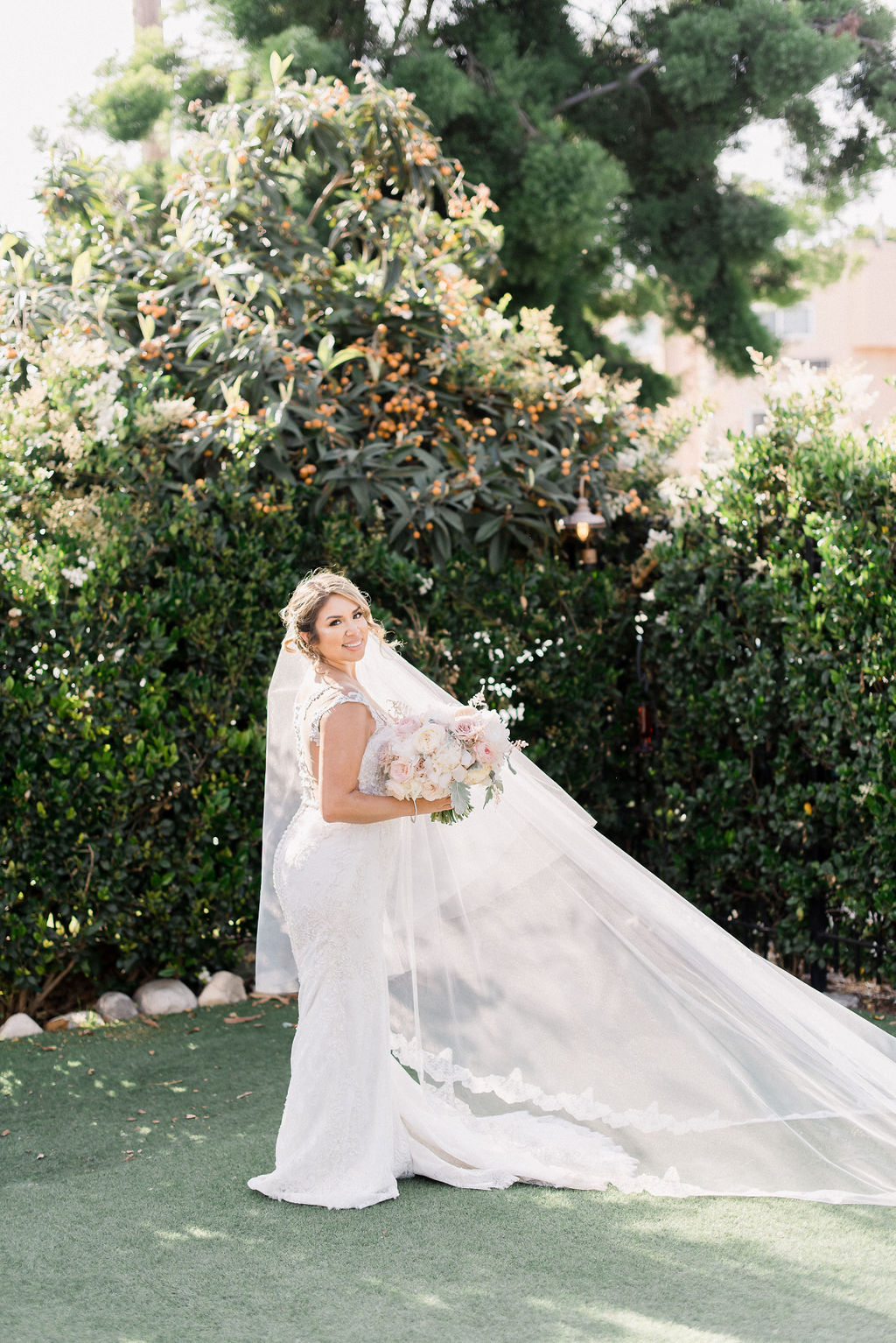 bride portrait with veil blowing in the wind