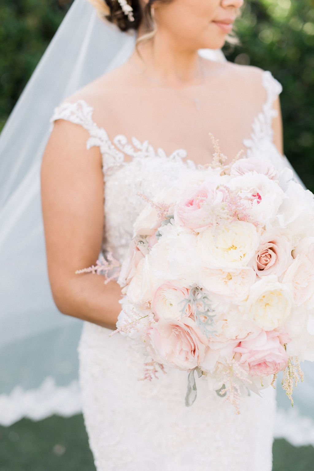 closeup of bride's pastel colored rose bouquet