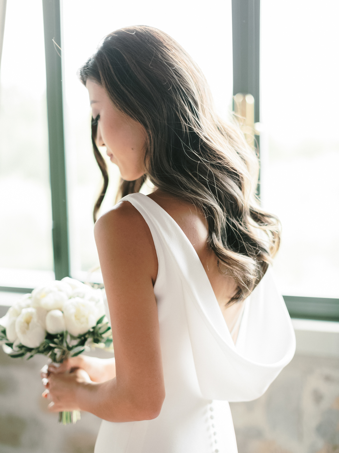 bride with simple low back pronovias dress