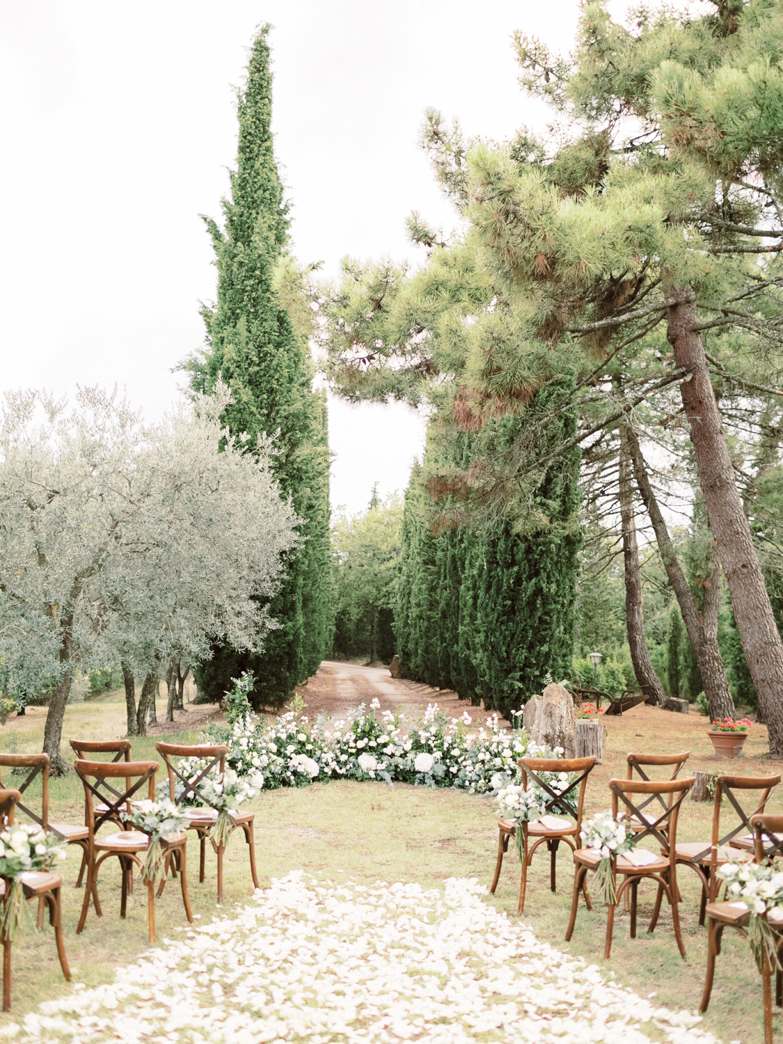 wedding ceremony setup outside of Villa Olimpia in Tuscany