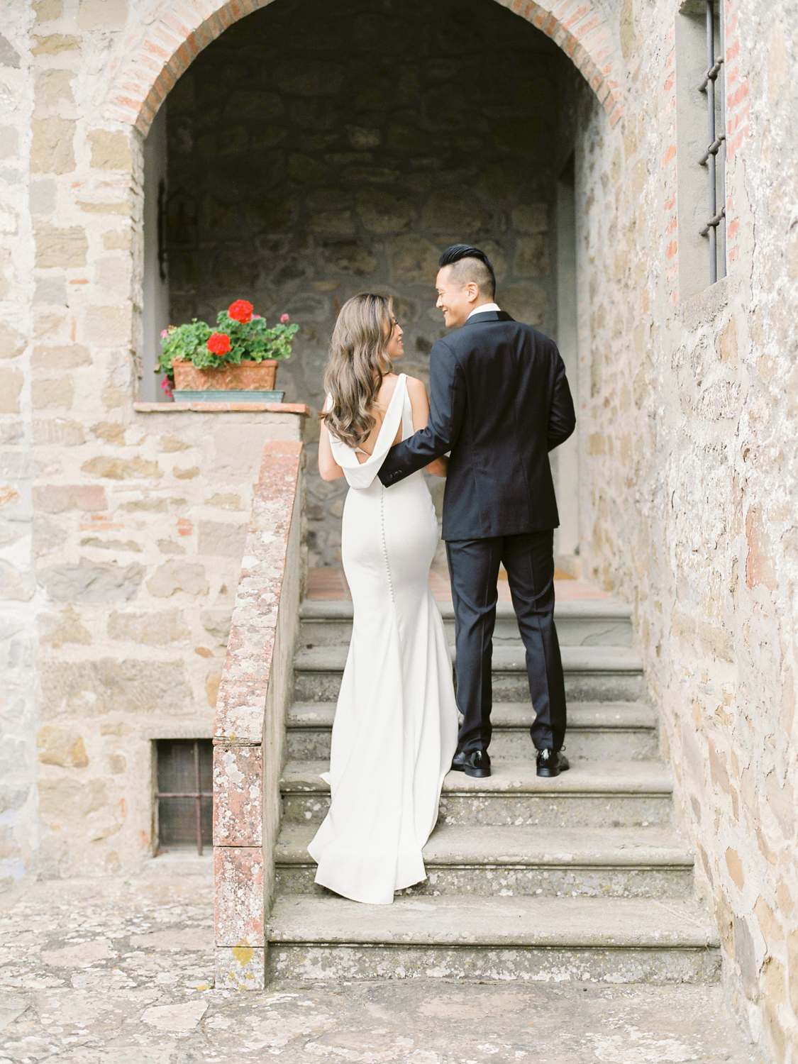 bride and groom walking up the stair of a Tuscan Villa