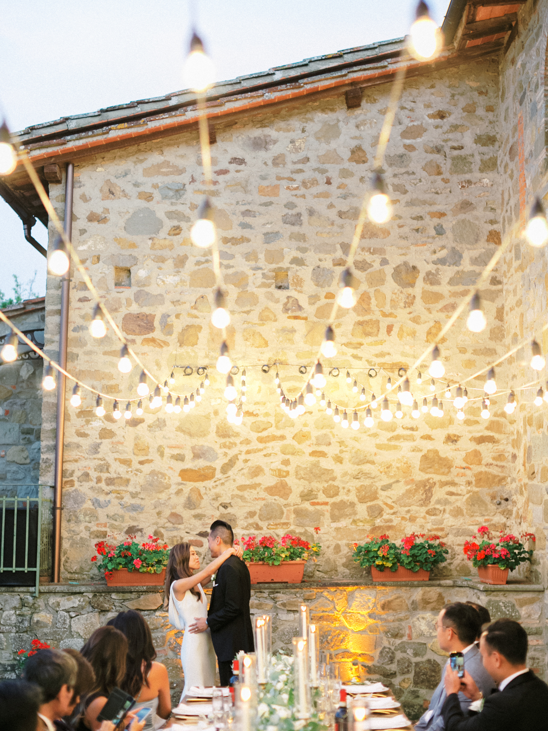 outdoor wedding on a patio with string lights