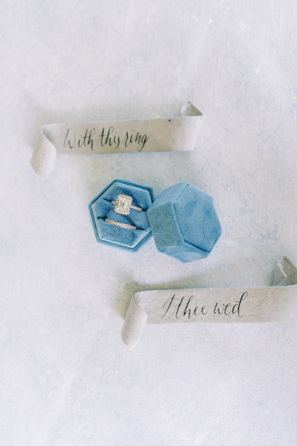 engagement ring and wedding band in a two ring velvet blue ring box