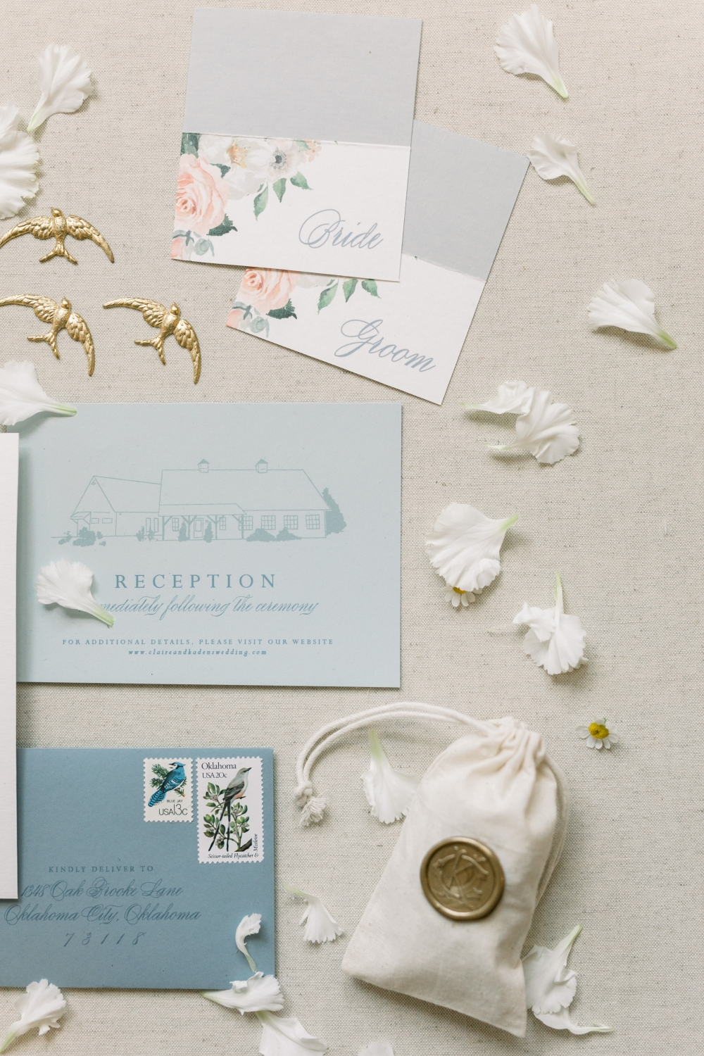 light blue wedding invitation suite with floral watercolor designs