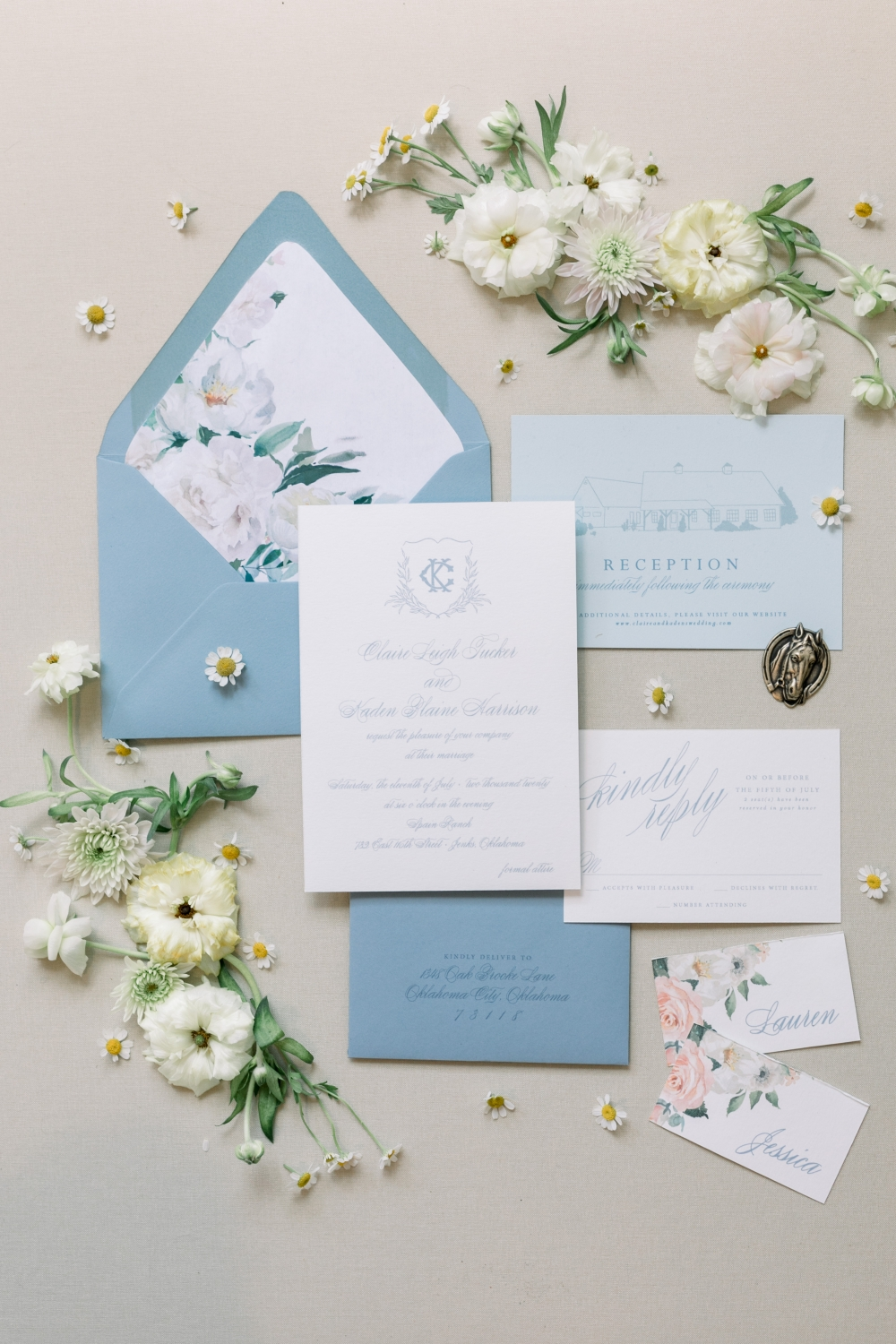 blue wedding invitation with custom monogram and water color flower liner