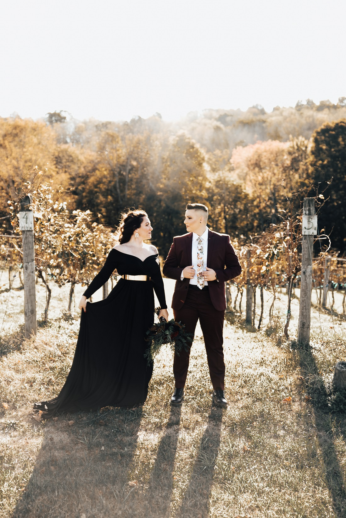 bride in a black dress with a gold belt