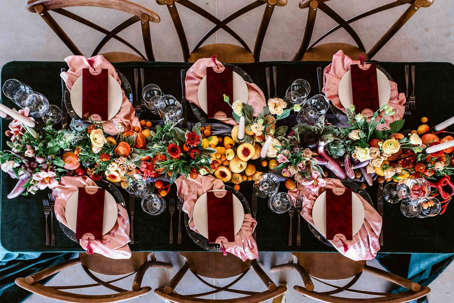 top view of a banquet table with crimson red napkins