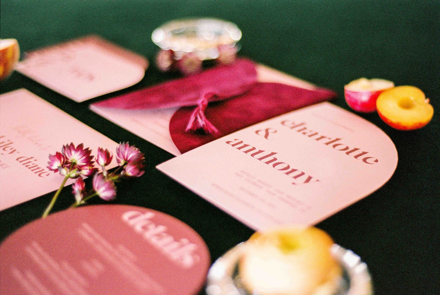 velvet red invitation suite on a green table cloth
