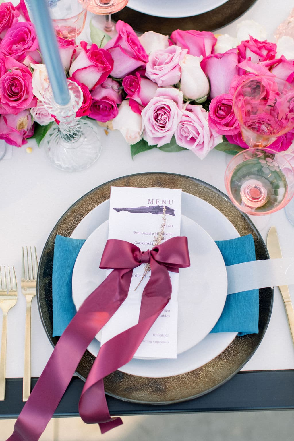 full shot of an example table setting with a purple bow