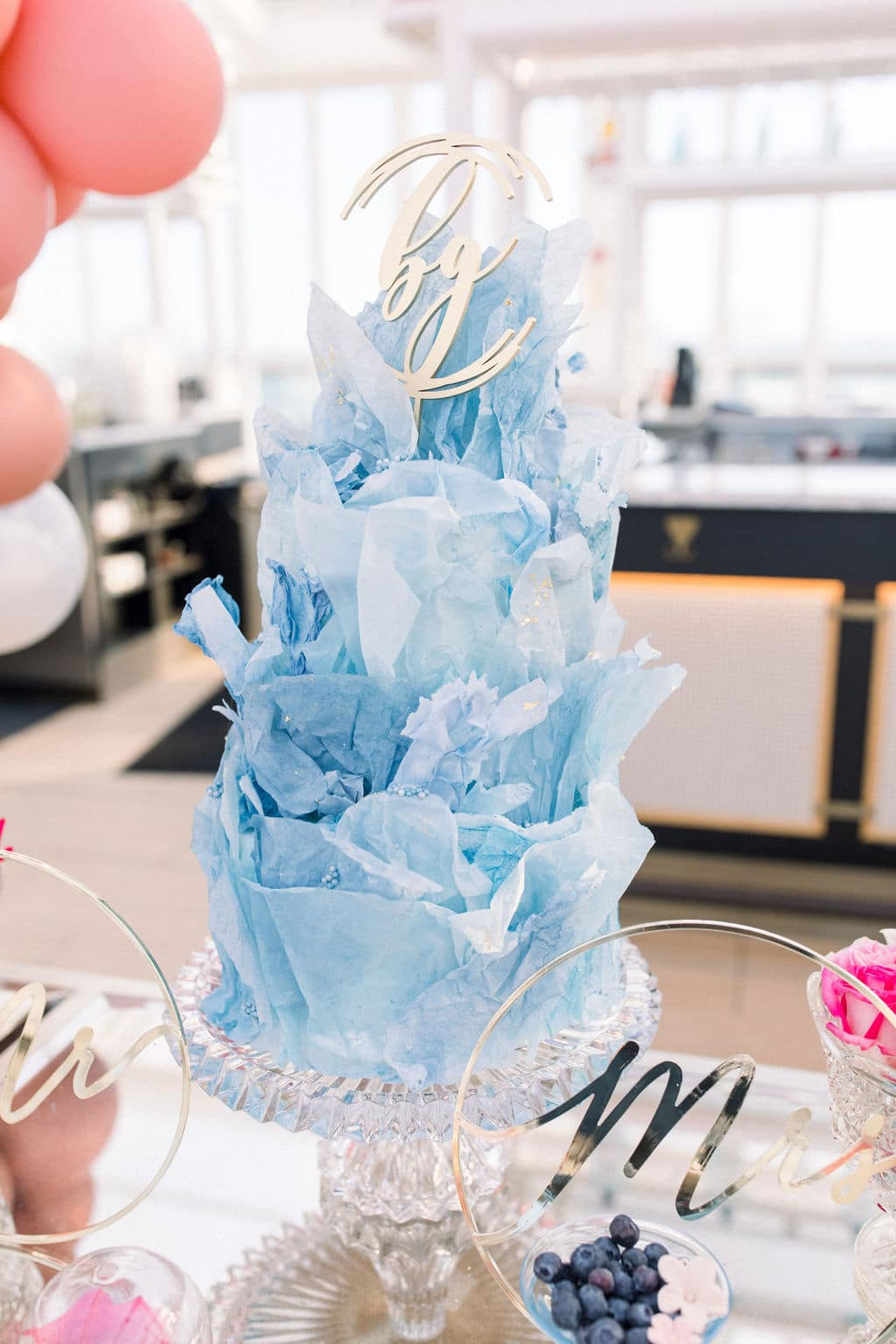 blue fluffy wedding cake with floral and beautiful details