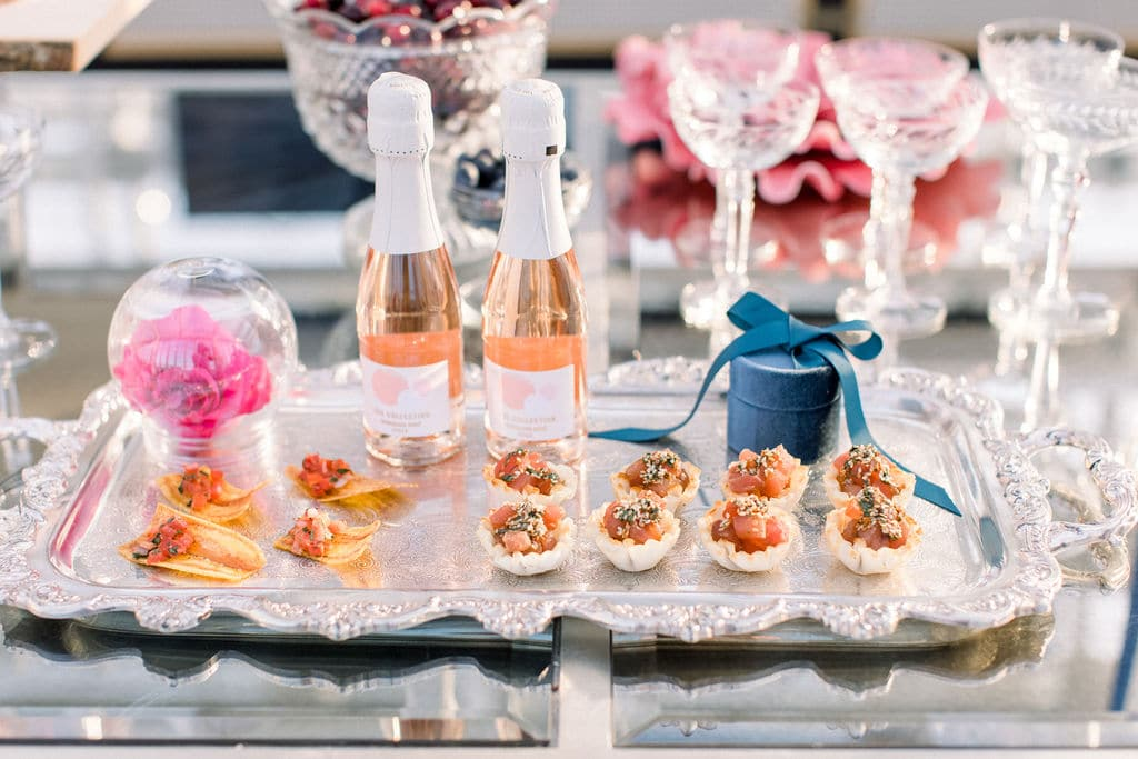bubbly champagne and sweets accompanied by berries to match the pink wedding berry theme