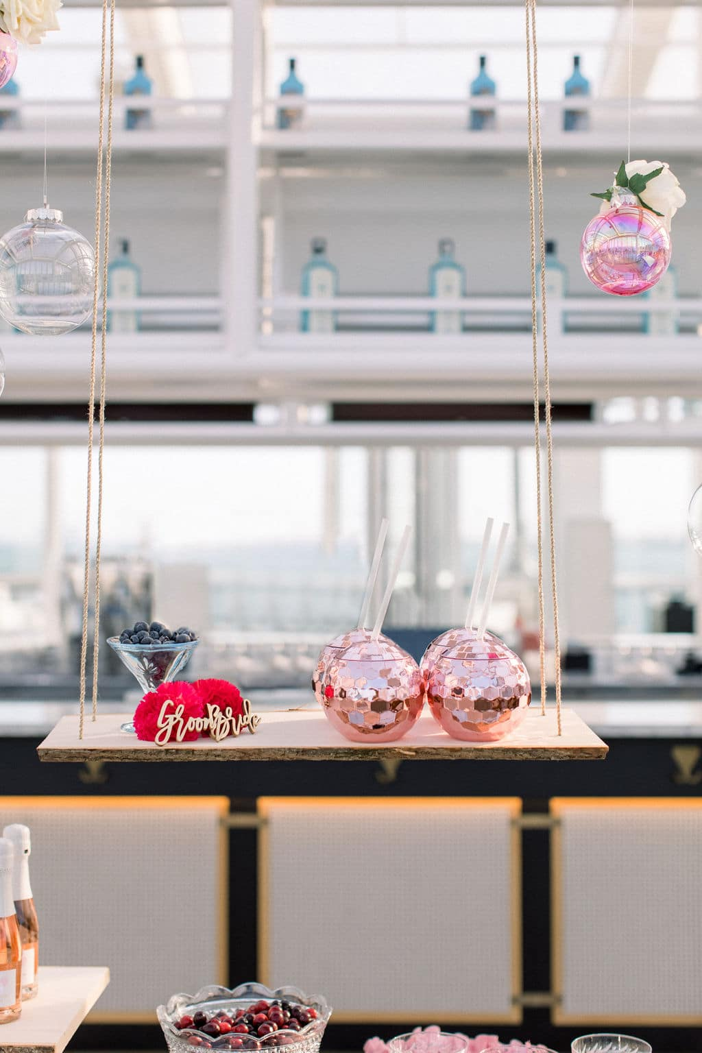 the champagne cheers bar is a great touch for guests because it is easily accessible on the hanging table