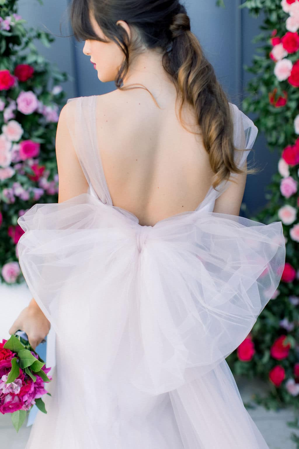 the back of the bride with straps and heart shaped fabric