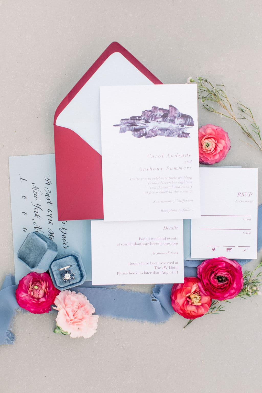red, blue, and purple stationary with ring in blue box