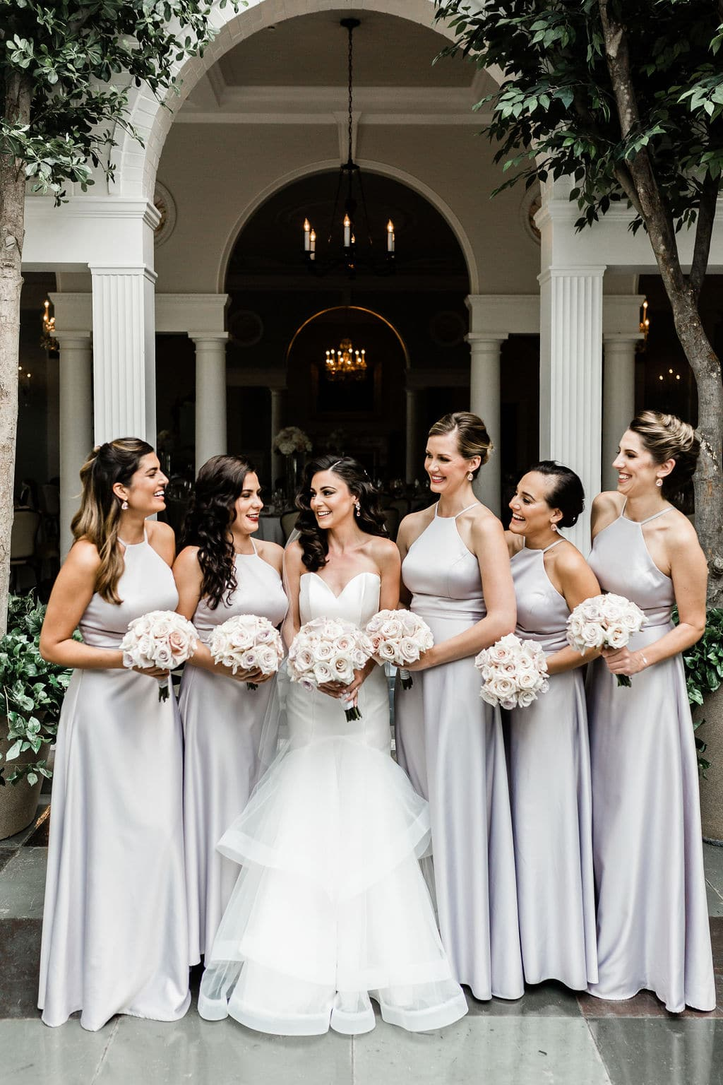 bride with bridesmaids in silver gowns