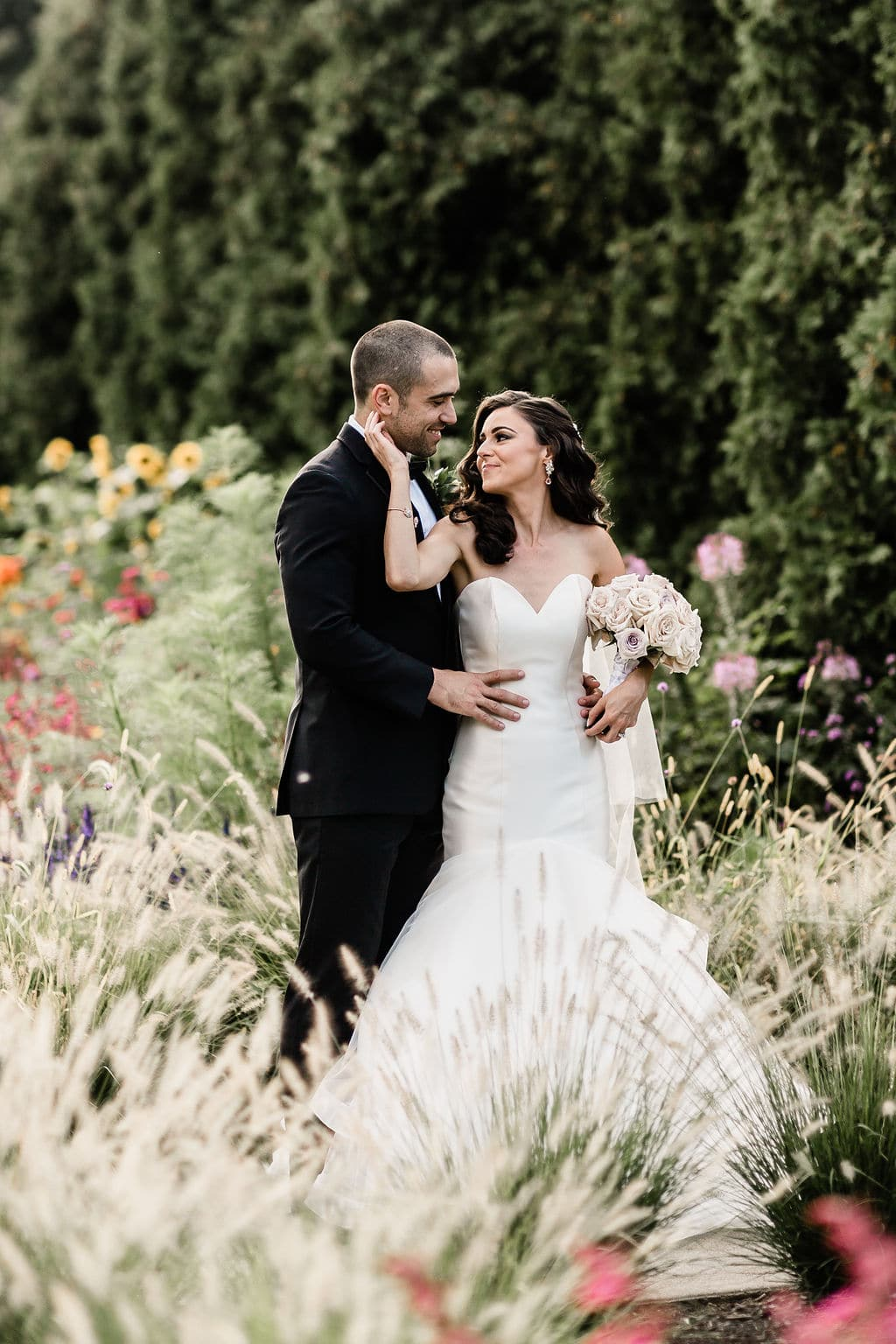 bride and groom romantic pose in garden