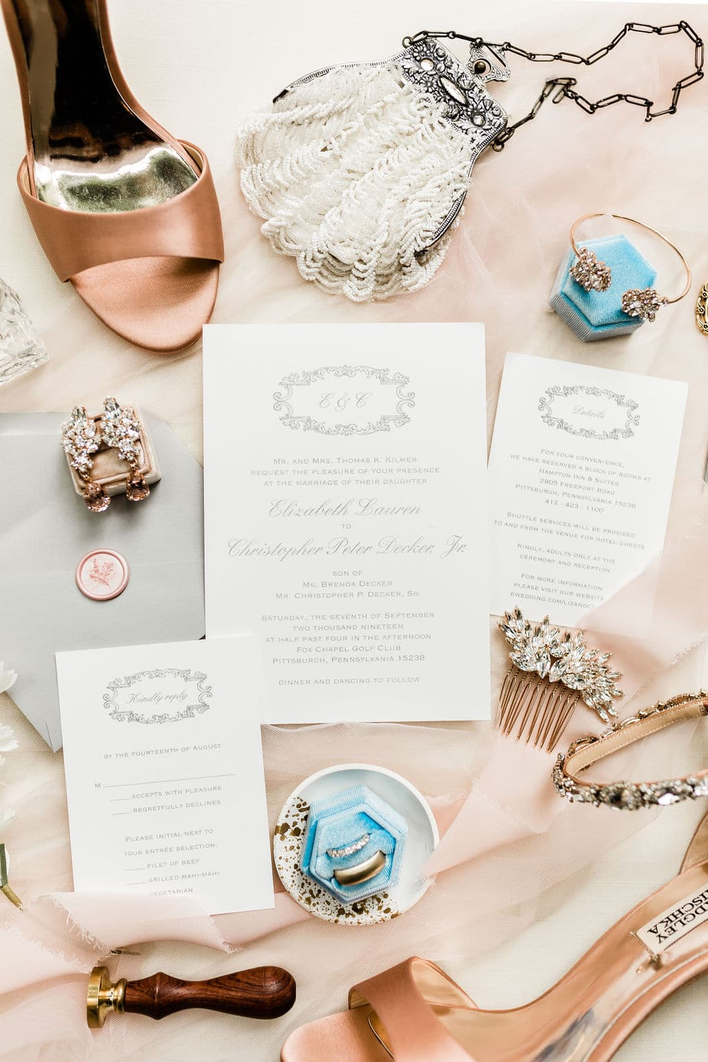 accessories and blue box with bride's ring with invitation to ceremony