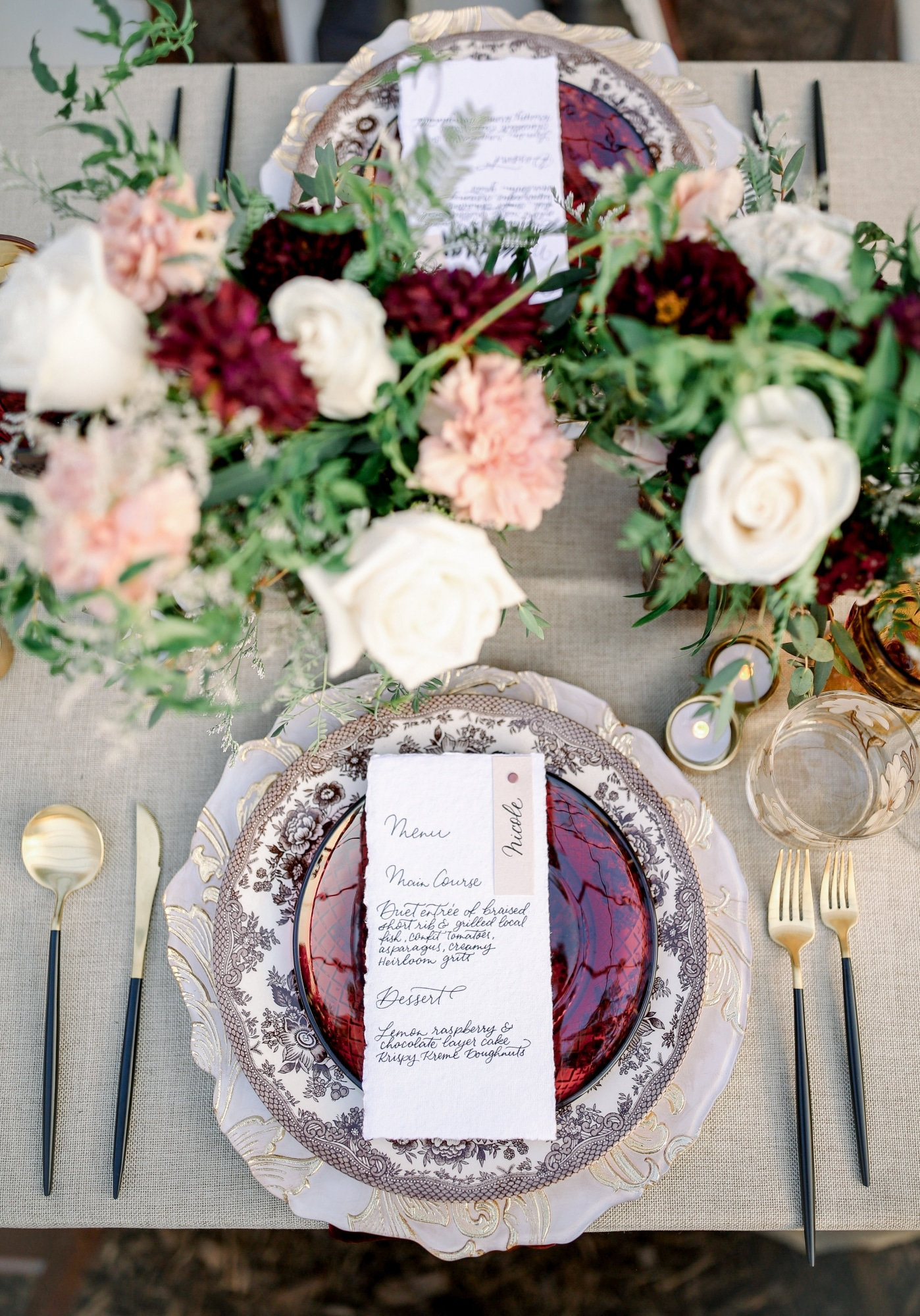 roses of all colors between two table settings with red and menus