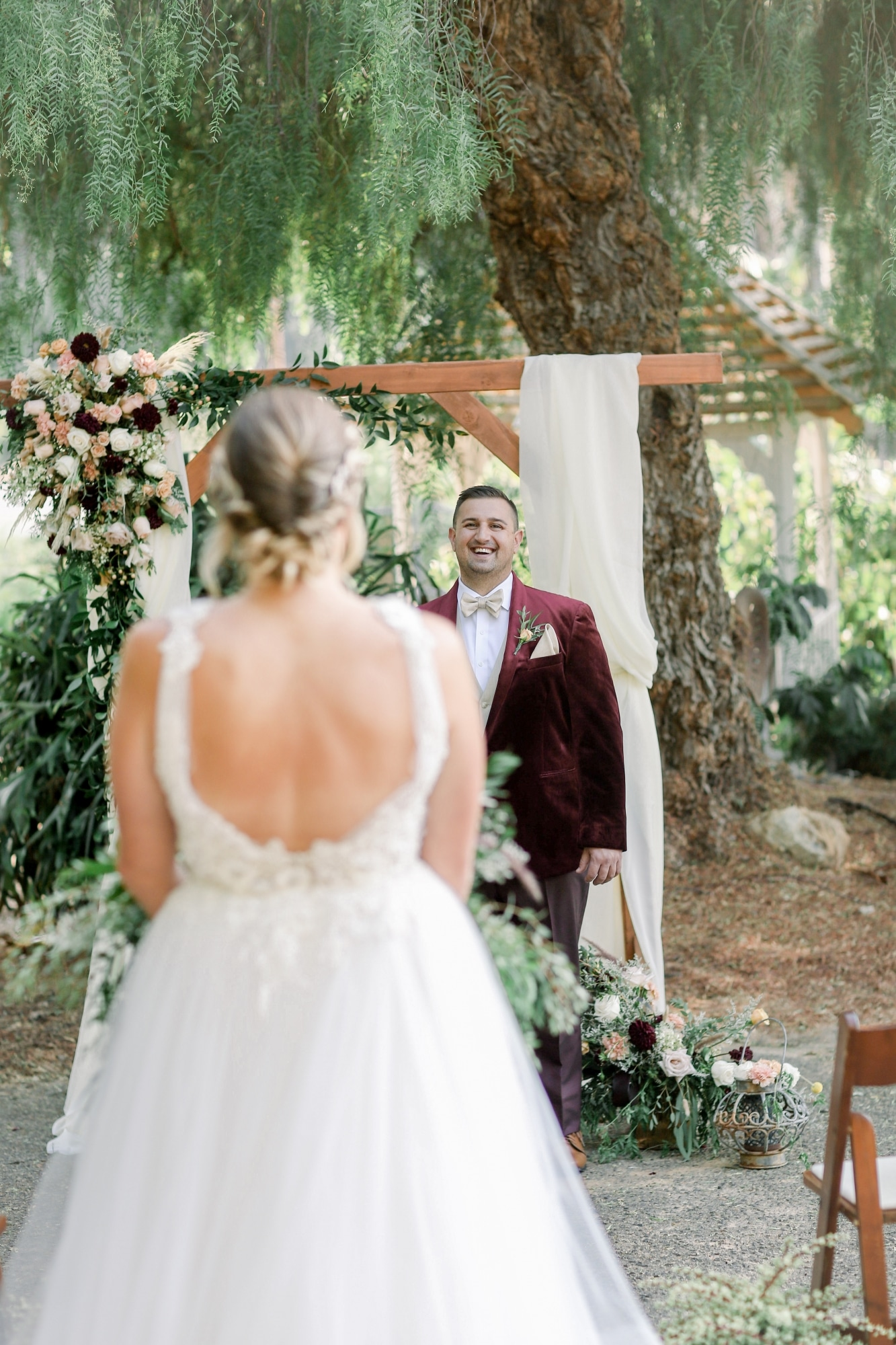 groom smiling as the bride walks down the aisle