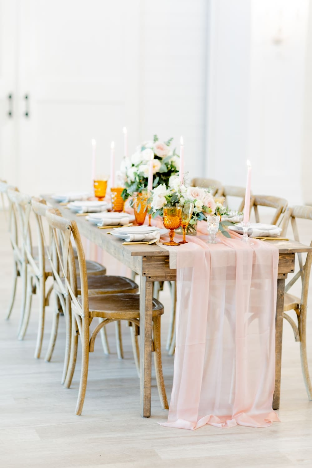 rustic fall wedding table with blush pink runner and orange glasses