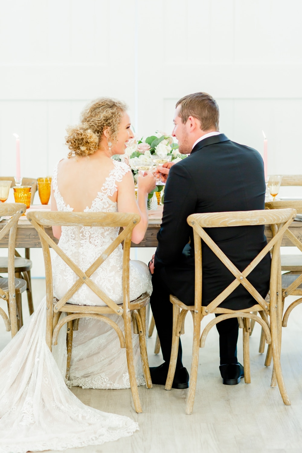 wedded couple at fall farm rustic wedding chair and table
