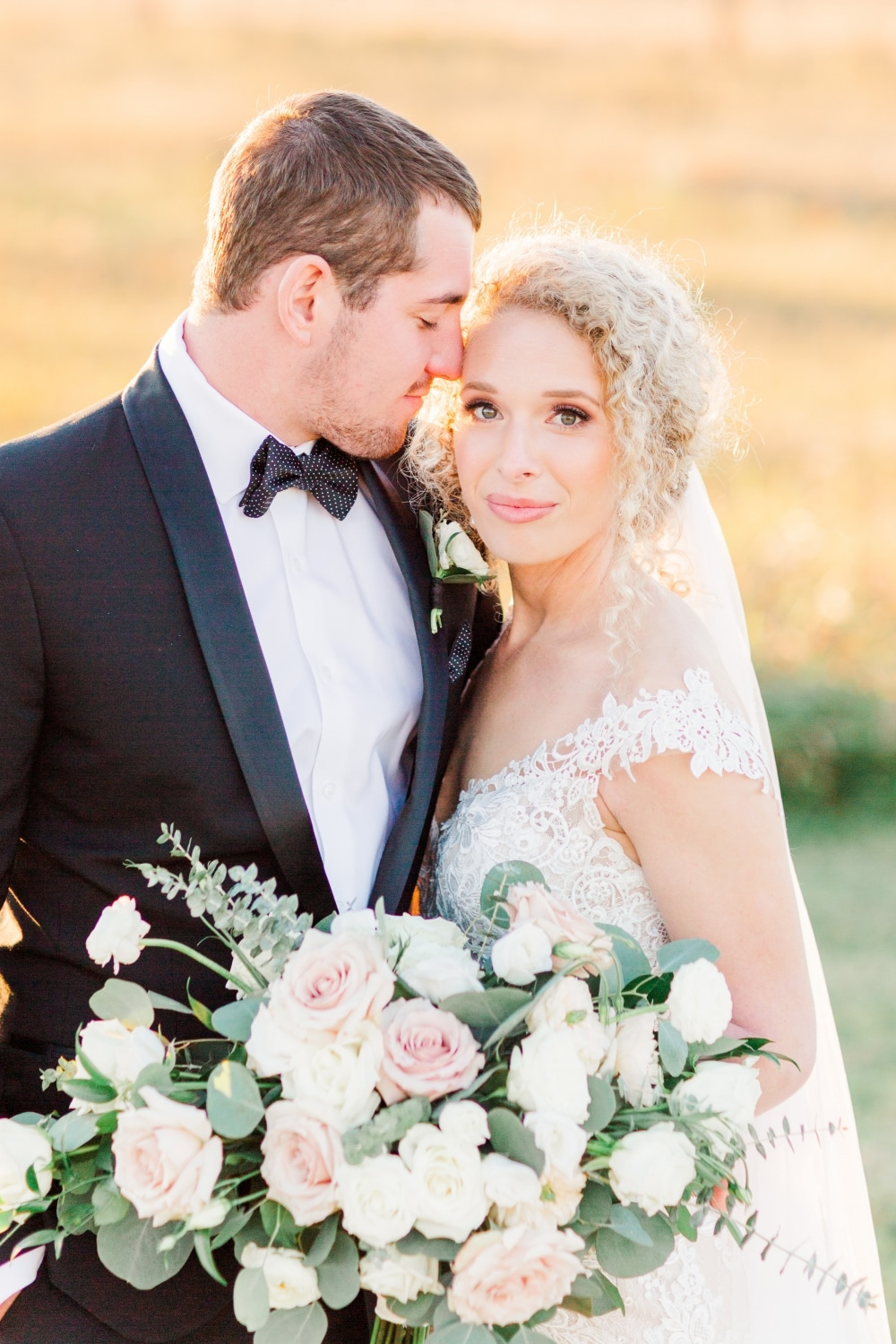 closeup of couple in fall white barn weding