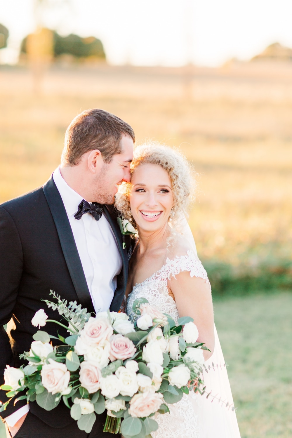 farm fall wedding with couple and white rose bouquet