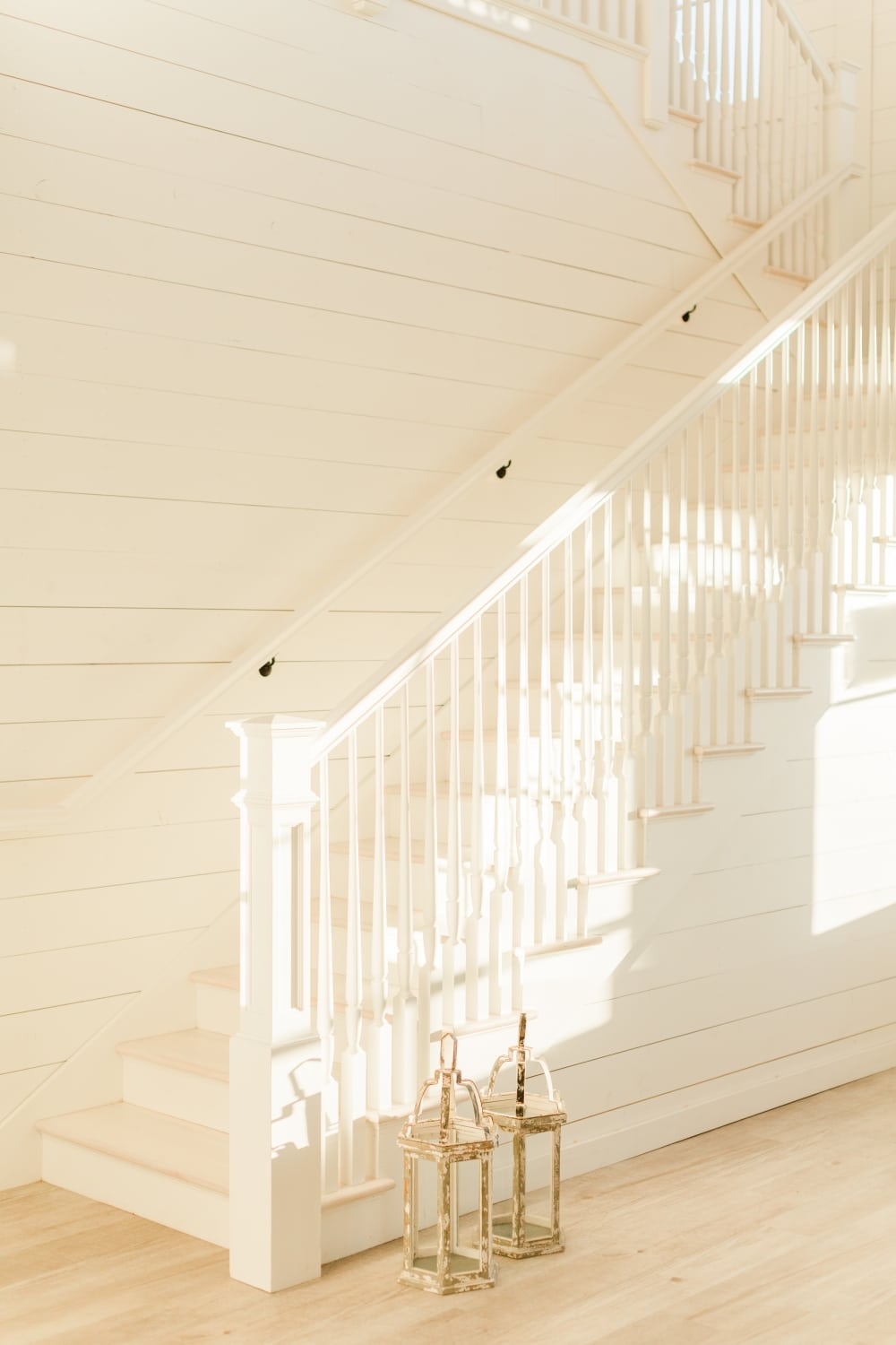white staircase with shadows of wedding venue