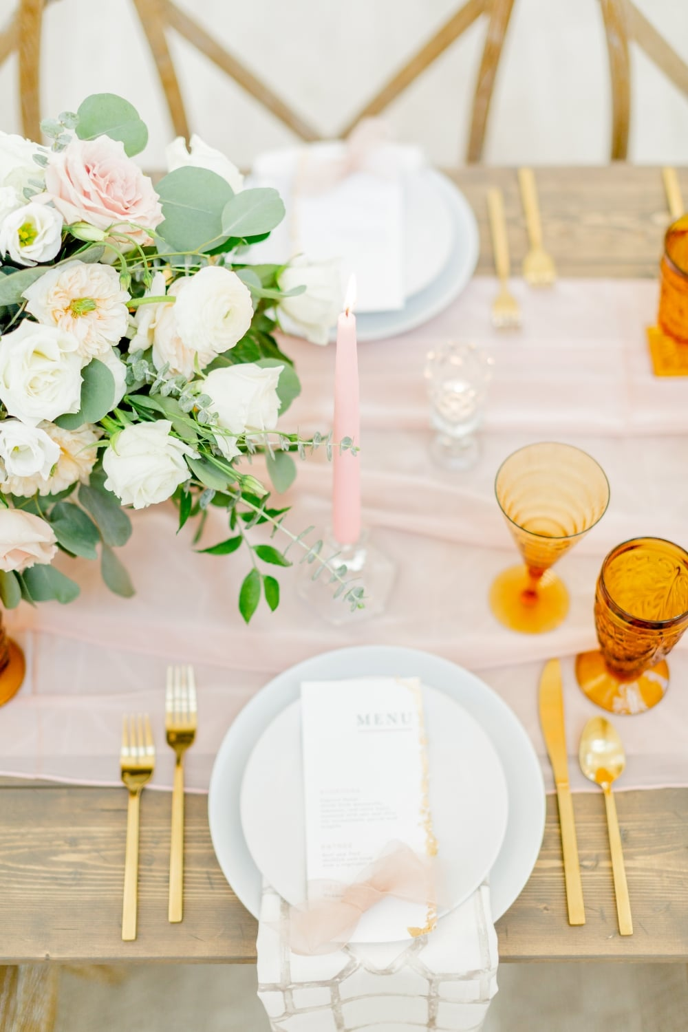 menu on top of table setting with pin runner