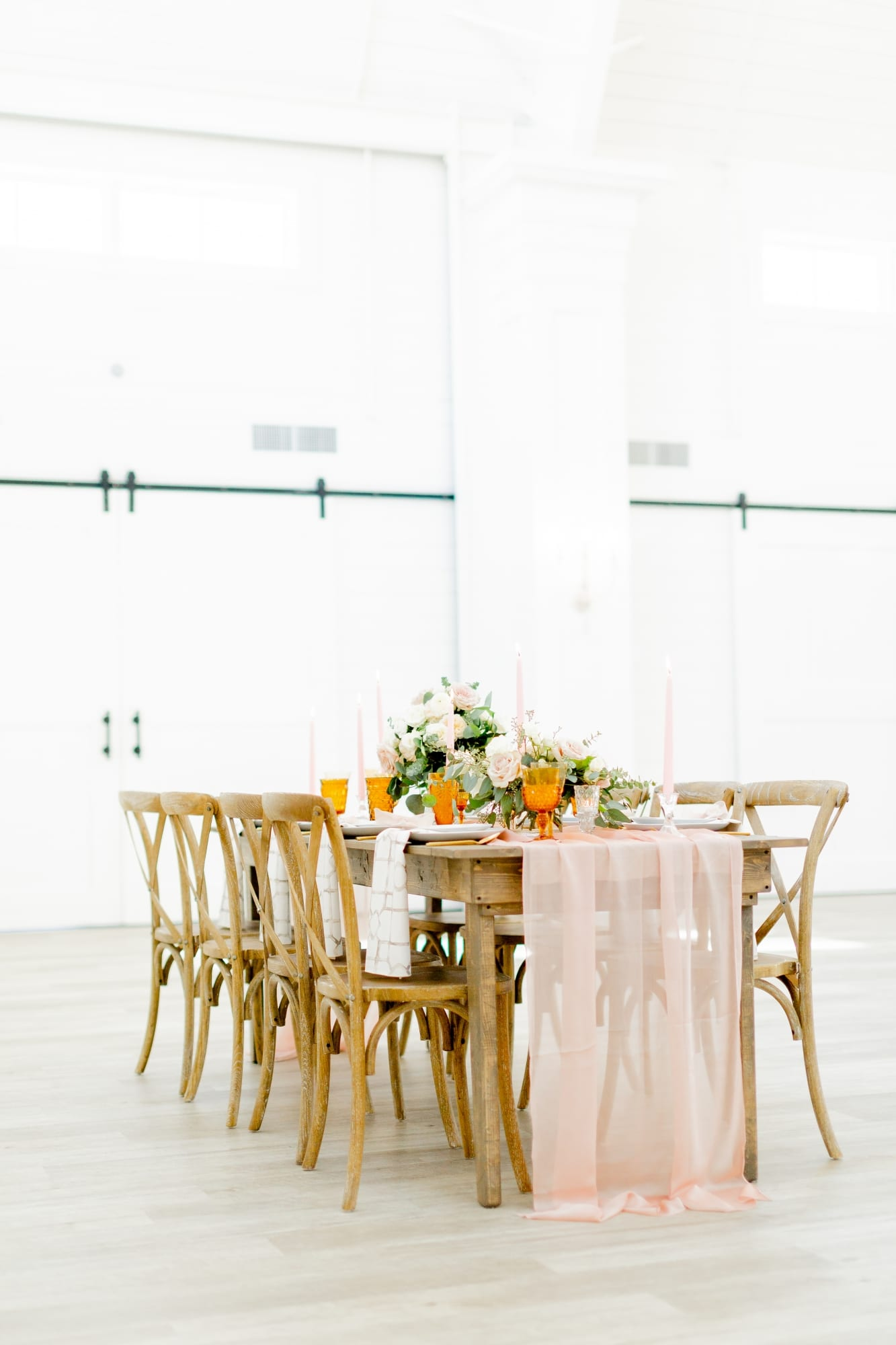 further shot of rustic far wedding table with pink runner