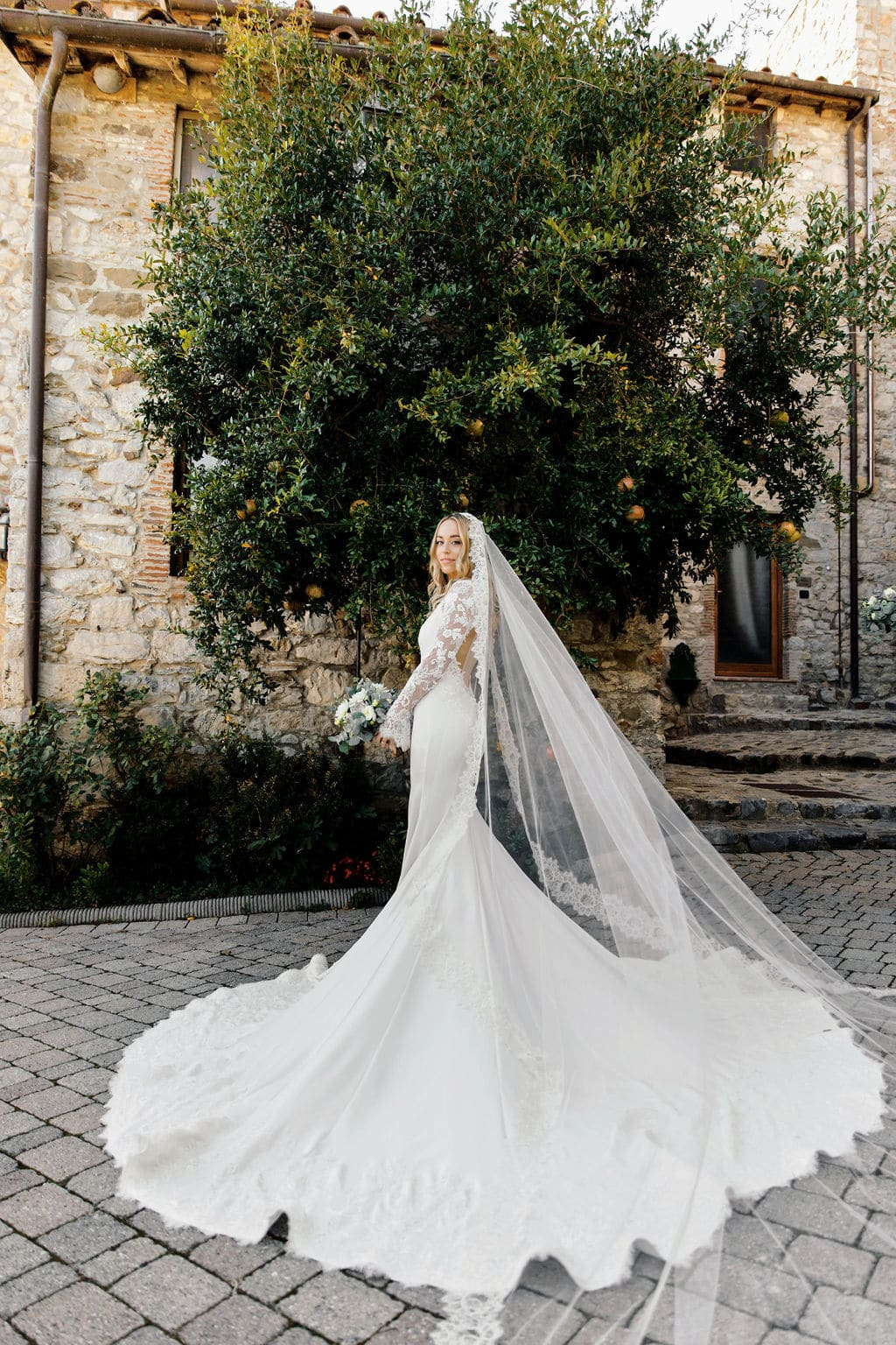 stunning boho bride and wedding gown with long lace veil