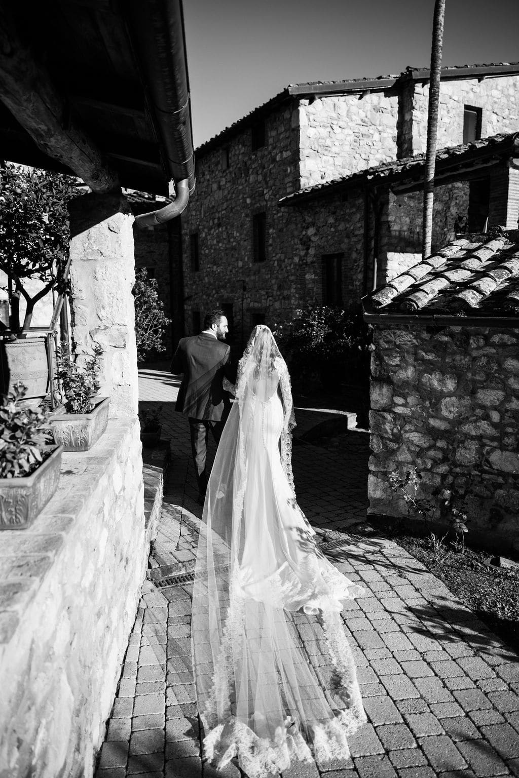 black and white picture of lace veil and bride