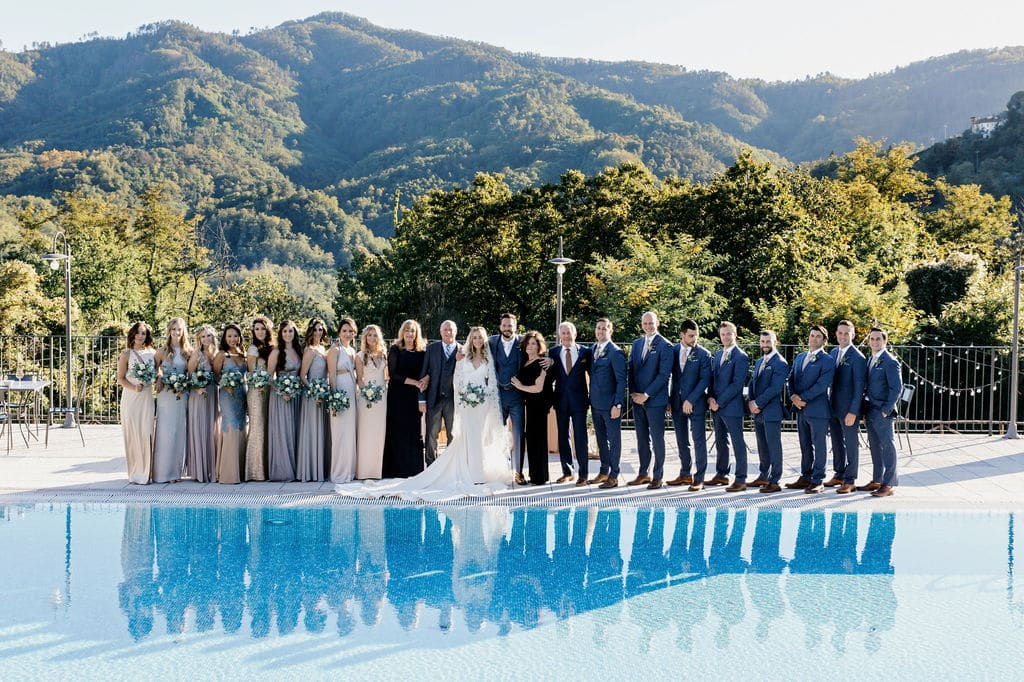 wedding party in front of pool at outdoor boho