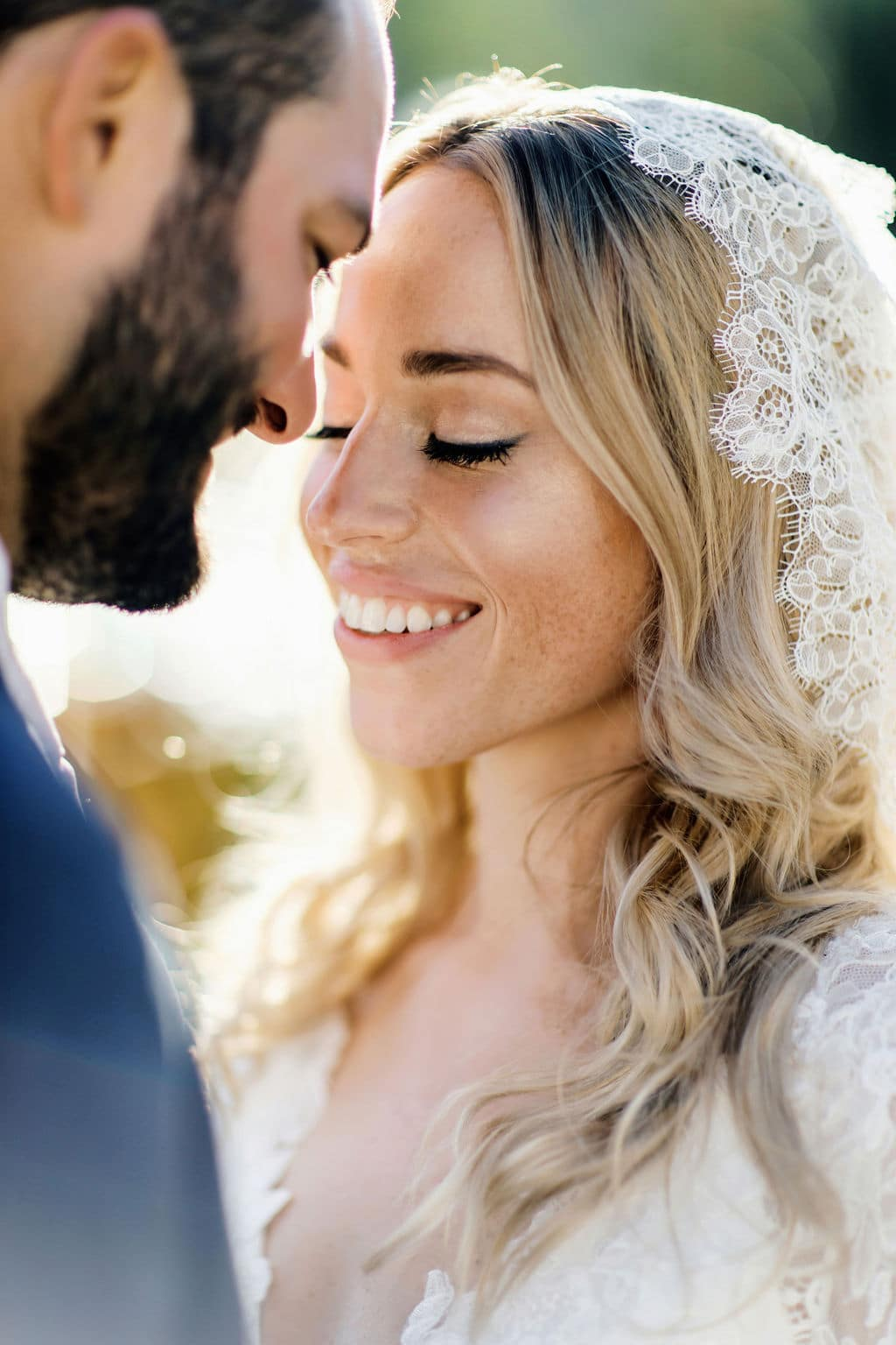 lace veil and close up shot of bride and groom