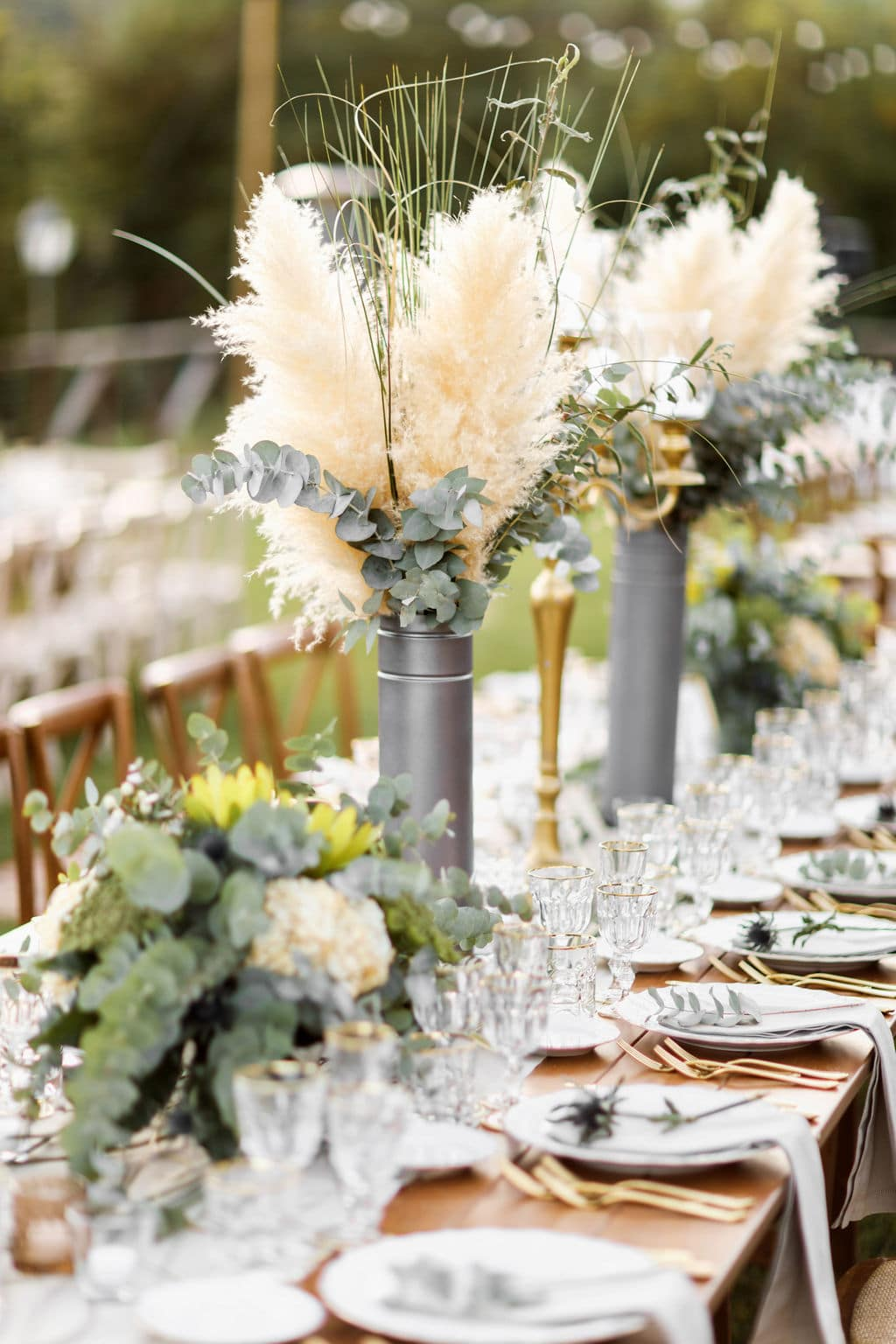 tall feathered wedding piece table centers with greenery