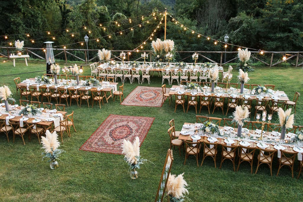 outdoor table settings boho wedding with lights and dance floor