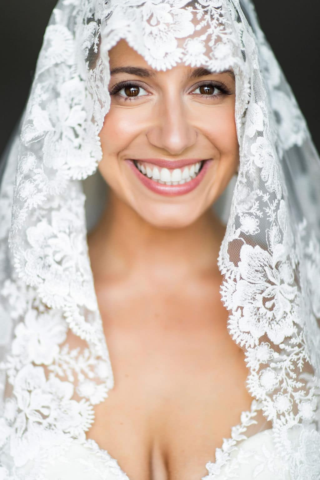 beautifully hand made lace veil on portrait of bride