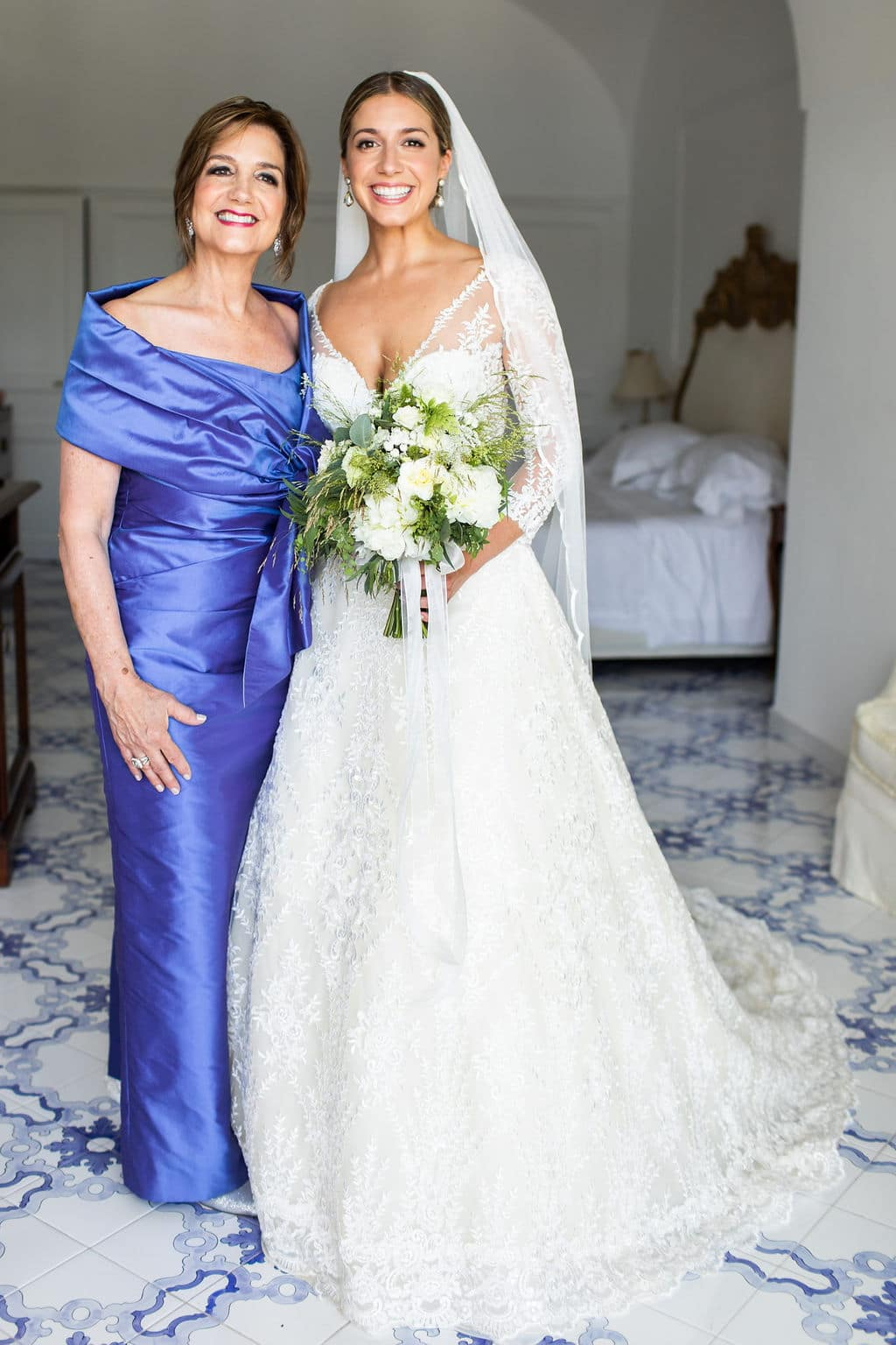 mother of the bride with the bride before the ceremony in italy and blue and white floors