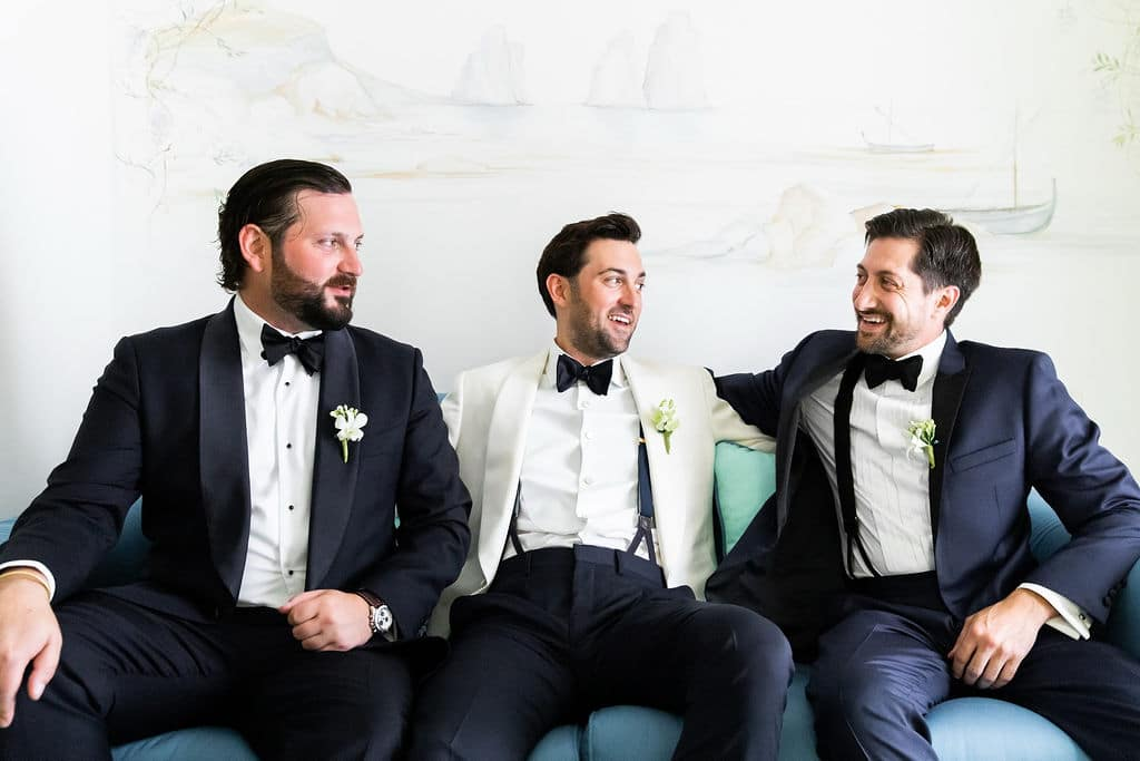 groom and groomsmen chilling before the wedding ceremony