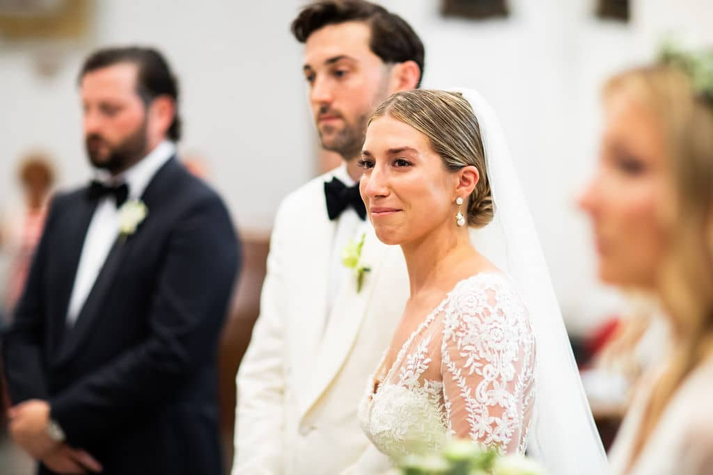 closeup of bride and groom during ceremony in italy