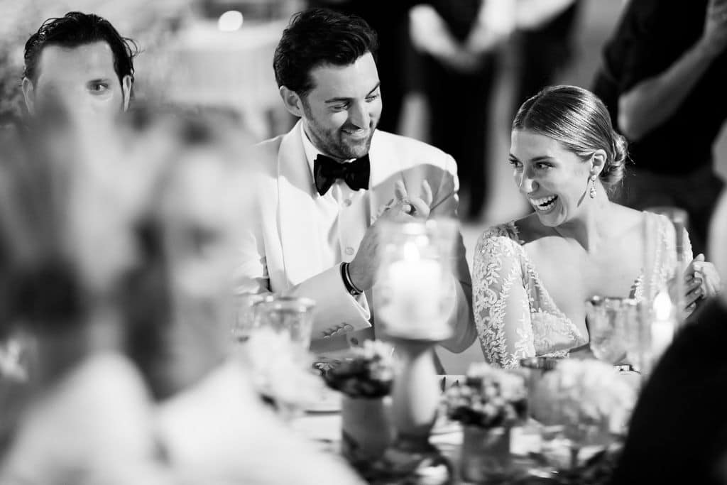 bride and groom smiling in black and white photo